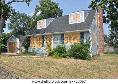 Down Economy Foreclosure House - stock photo