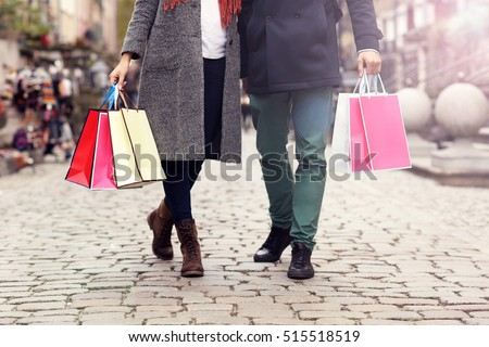 Down section of people with shopping bags in the city