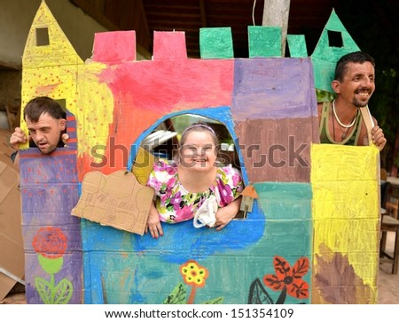 down syndrome couple and gypsy man - stock photo