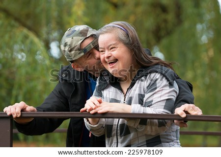 Down syndrome couple in love  - stock photo