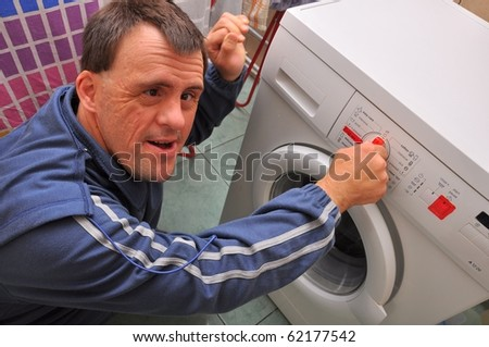 down syndrome man washing - stock photo