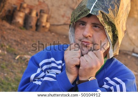 down syndrome man with plastic bag - stock photo