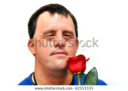 down syndrome man with red rose - stock photo