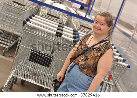 down syndrome woman walking to shopping - stock photo