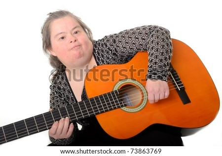 down syndrome woman with guitar - stock photo