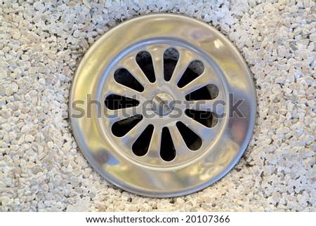 down the drain. - stock photo