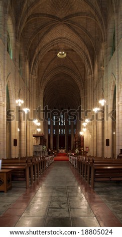 Down the long aisle at the cathedral - stock photo