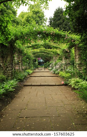 Down the path of an English Country Garden - stock photo