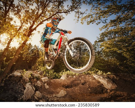 Downhill. Man riding a mountain bike. Extreme cycling.