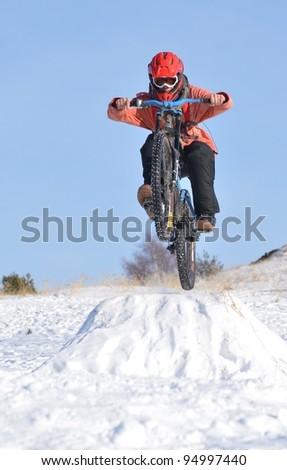 downhill mountain bike in winter - stock photo