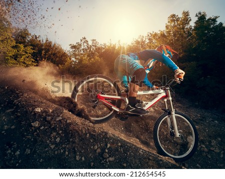 Downhill mountain bike. Man cyclist to riding a bicycle. - stock photo