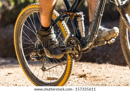 Downhill mountain bike on a forest path - stock photo