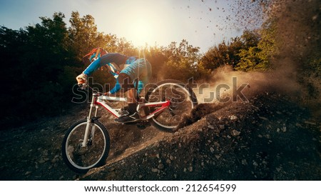 Downhill mountain bike. Young man cyclist to riding a bicycle. - stock photo