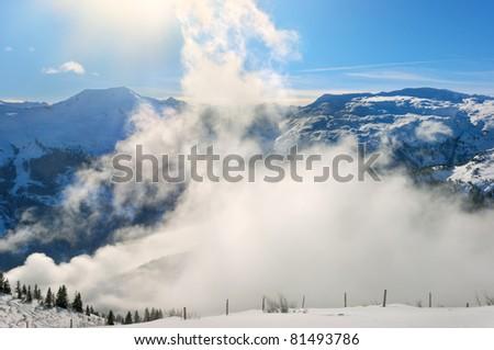 downhill ski slope at sunny winter day - stock photo