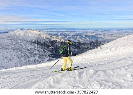 Downhill Skier in Kasprowy Wierch in Zakopane in Tatras in winter. Zakopane is a town in Poland in Tatra Mountains. Kasprowy Wierch is a mountain in Zakopane and the most popular ski area in Poland - stock photo