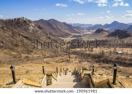 Downhill stairs among the mountains in Terelj, Mongolia - stock photo