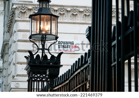 Downing Street's sign in Westminster. Downing St. has housed government leaders for over three hundred years. - stock photo