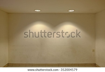 Downlight illuminating a blank display stage.  - stock photo