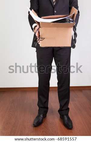 Downsized employee with belongings - stock photo