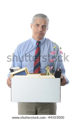 Downsized Middle Aged Businessman carrying a box of personal belongings isolated on white vertical format - stock photo