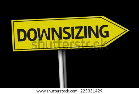 Downsizing creative sign on black background - stock photo