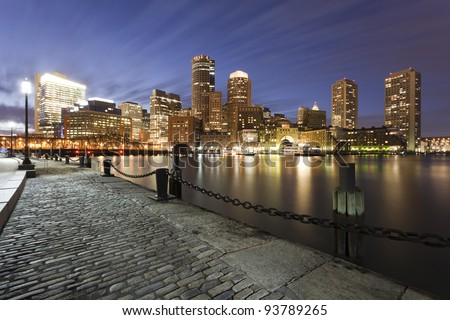 Downtown Boston, MA skyline  at dusk from South Boston's Fort Point area. - stock photo
