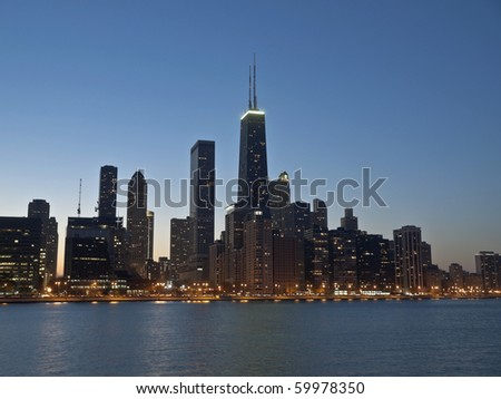 Downtown Chicago and the Lake Michigan shore at night. - stock photo
