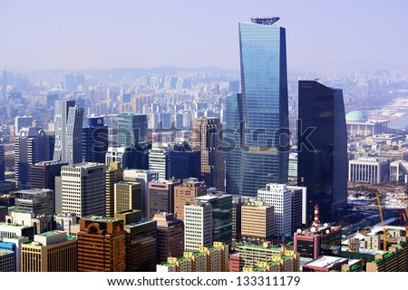 Downtown cityscape of Seoul, South Korea on a smoggy day. - stock photo