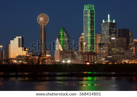 Downtown Dallas, Texas at night with the Trinity River in the foreground