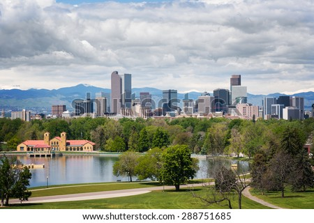 Downtown Denver, as seen from City Park, on a cloudy day. - stock photo
