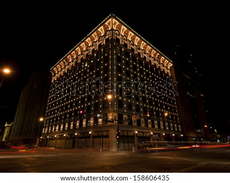 Downtown Denver at Christmas. Gas and Electric Company's building decorated with lights. - stock photo