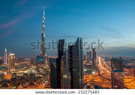 DOWNTOWN DUBAI, UAE - Feb 11: Burj Khalifa, the tallest skyscraper in the world standing at 829.8m in Dubai on Feb 11,2014. Construction began in 2004 and officially opened in 2010. Shot at Blue hour. - stock photo