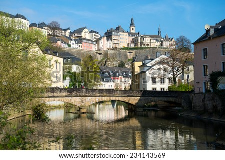 Downtown Grund of Luxembourg City, view with a bridge across the Alzette river - stock photo