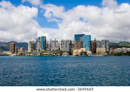 Downtown Honolulu Skyline with boats and skyscrapers fronting Honolulu Harbor