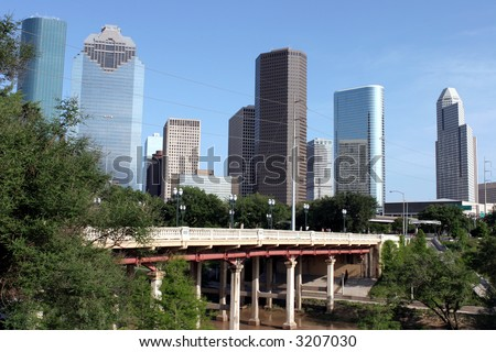 Downtown Houston and bayou bridge viewed from a park