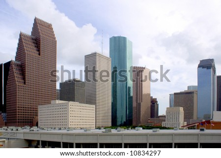 downtown houston texas with a cloudy sky - stock photo