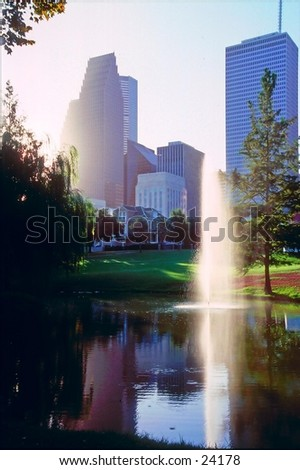 Downtown Houston, Texas with water fountain and pond reflection. - stock photo