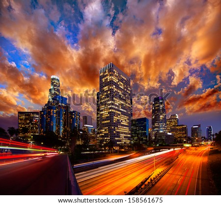 Downtown LA night Los Angeles sunset skyline California from 110 freeway  [ photo-illustration] - stock photo