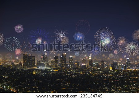 Downtown Los Angeles cityscape with empty place for text on a dark sky and flashing fireworks celebrating New Year's Eve. - stock photo
