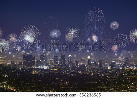 Downtown Los angeles cityscape with many flashing fireworks celebrating New Year's Eve - stock photo