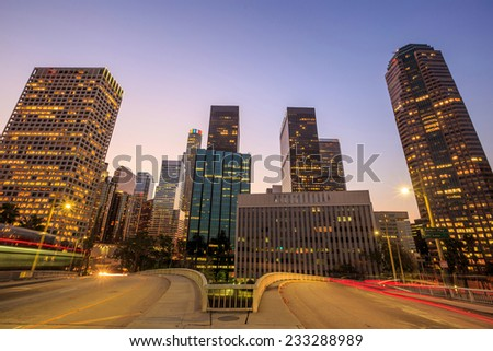 Downtown Los Angeles skyline during rush hour at sunset - stock photo