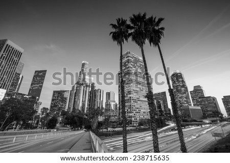Downtown Los Angeles skyline during rush hour at sunset, black and white  - stock photo