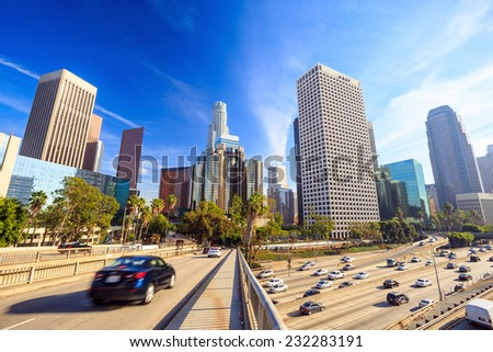 Downtown Los Angeles skyline during rush hour with blue sky  - stock photo
