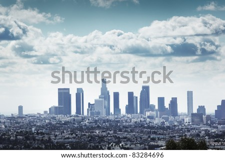 Downtown Los Angeles skyline over blue cloudy sky - stock photo