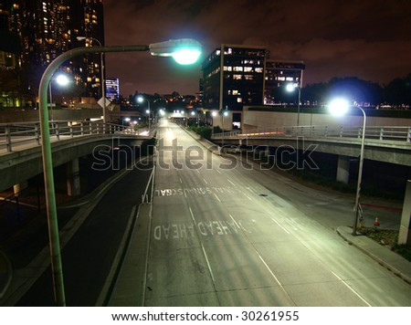 Downtown Los Angeles street and ramps late at night. - stock photo
