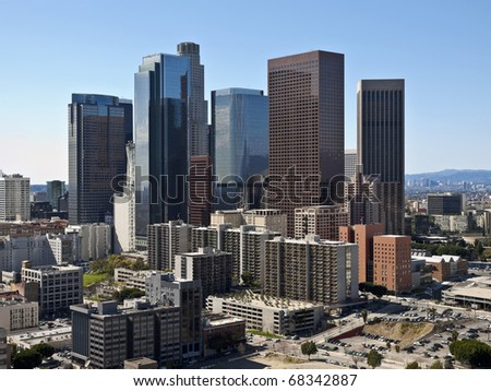 Downtown Los Angeles towers and apartments on a clear winter day.