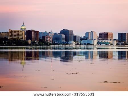 Downtown Madison seen acrross Lake Monona, sunset time. Madison, Wisconsin, USA. - stock photo