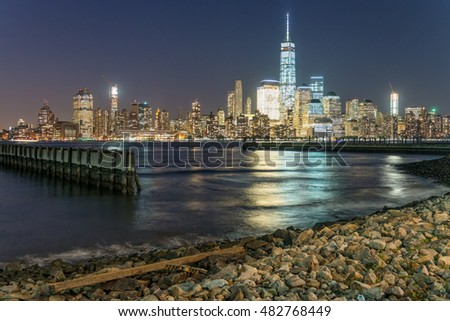 Downtown Manhattan and water reflections at sunset, new York City.