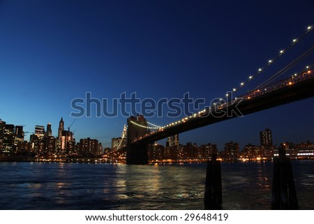 downtown manhattan, brooklyn bridge new york at night during blue hour seen from brooklyn - stock photo