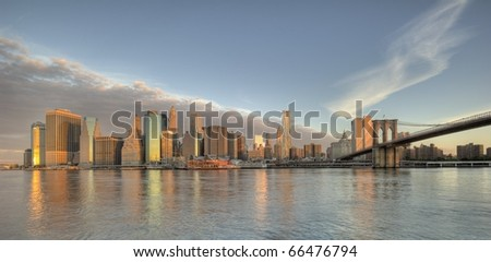Downtown Manhattan buildings including the Brooklyn Bridge - stock photo